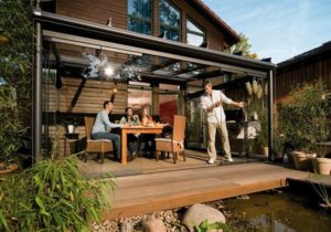 glass room four people outdoor Garden socialising in the garden